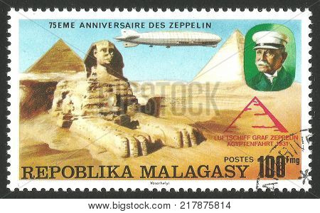 Malagasy Republic ( Madagascar ) - stamp printed 1976 Multicolor memorable Edition offset printing Topic Aviation Series 75 years Zeppelin airship Airship LZ -127 Graf Zeppelin over Sphinx Egypt