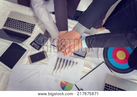 Business team making hands stack and joint together.