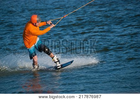 Concentrated Wakeboarder Is Making Trick