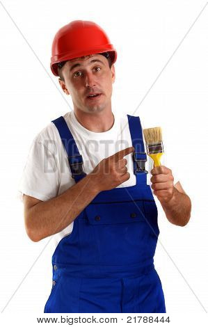Craftsman With A Red Safety Helmet Holding A Paintbrush