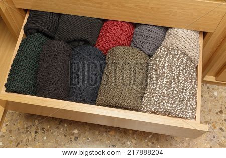 A well-organized closet drawer. neatly stacked in piles. Storage system. Wardrobe order.