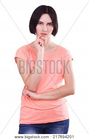Pretty young girl posing on the camera. Pretty lady with black hair in photo studio isolated on a white background. Close-up of girl.