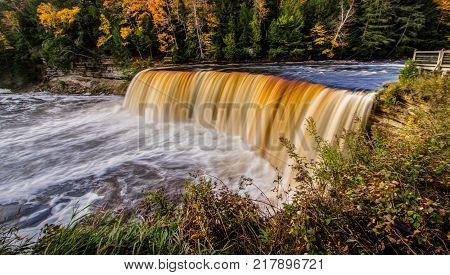 Scenic Michigan Autumn Waterfall Panorama. Upper Tahquamenon Falls  in the Paradise Newberry area of the Upper Peninsula in Michigan in Tahquamenon Falls State Park.