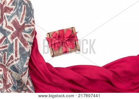 Decorative draping frame of the textile. Women's scarf red figure the British flag. White background top view. Gift box with surprise