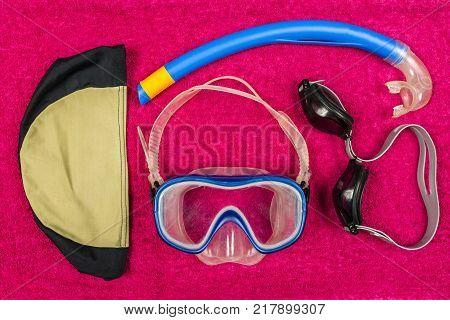 Diving kit for son and swimming goggles for father to swim in the indoor swimming pool.