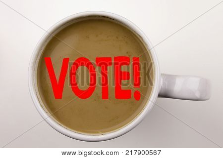 Word, writing Vote text in coffee in cup. Business concept for Voting Electoral Vote on white background with space. Black text with red word.