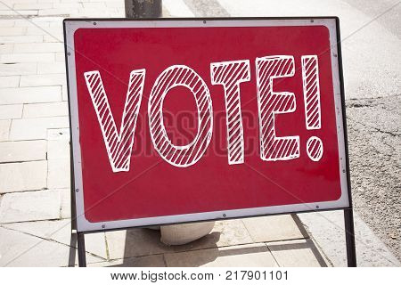 Conceptual hand writing text caption inspiration showing Vote. Business concept for Voting Electoral Vote written on announcement road sign with background and space