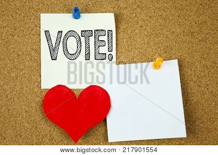 Conceptual hand writing text caption inspiration showing Vote concept for Voting Electoral Vote and Love written on sticky note, cork background with copy space