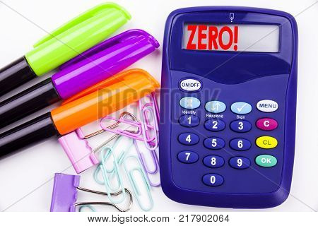 Writing word Zero text in the office with surroundings marker, pen writing on calculator. Business concept for Zero Zeros Nought Tolerance white background with space