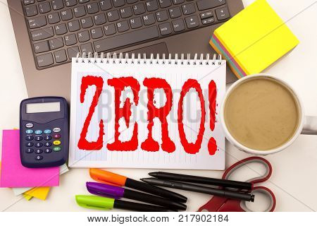 Word writing Zero in the office with  laptop, marker, pen, stationery, coffee. Business concept for Zero Zeros Nought Tolerance Workshop white background with space