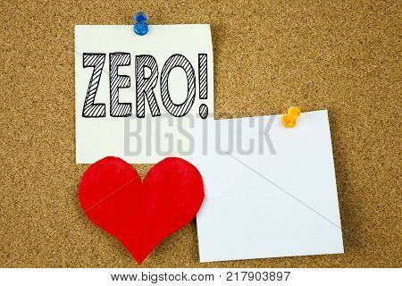 Conceptual hand writing text caption inspiration showing Zero concept for Zero Zeros Nought Tolerance and Love written on sticky note, cork background with copy space