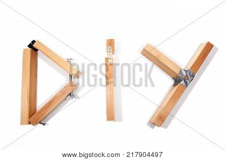 D.I.Y. disaster. Badly constructed wooden D I Y sign letters representing bad do it yourself. White background with copy space.