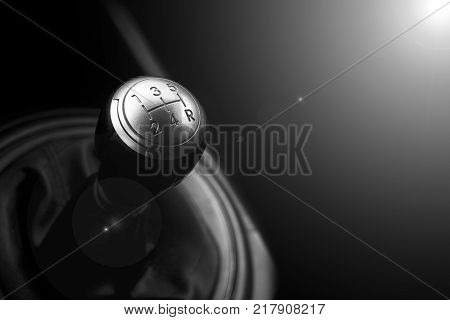 Close up view of a gear lever shift. Manual gearbox. Car interior details. Car transmission. Soft lighting. Abstract view. Black and white