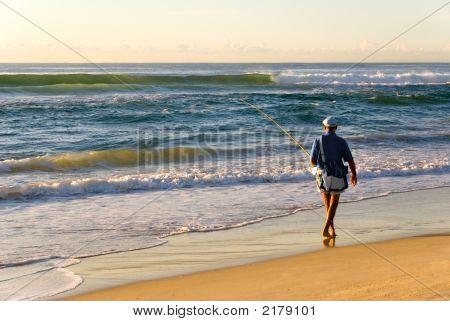 Beach Fisherman By Ocean As Sun Rises