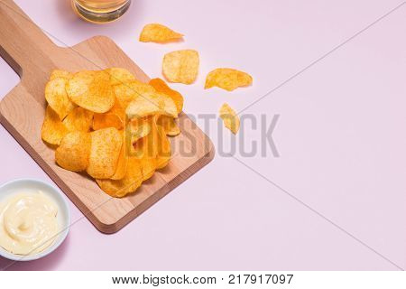 Concept of unhealthy food. potato chips on plate - unhealthy food
