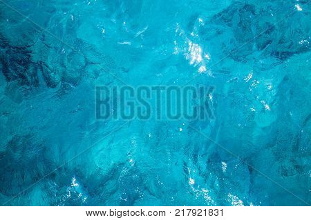 Blue ocean water surface natural background texture top view
