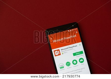 Los Angeles, december 11, 2017: Smartphone with Microsoft powerpoint application in google play store on red background
