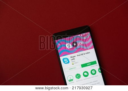 Los Angeles, december 11, 2017: Smartphone with Skype application in google play store on red background