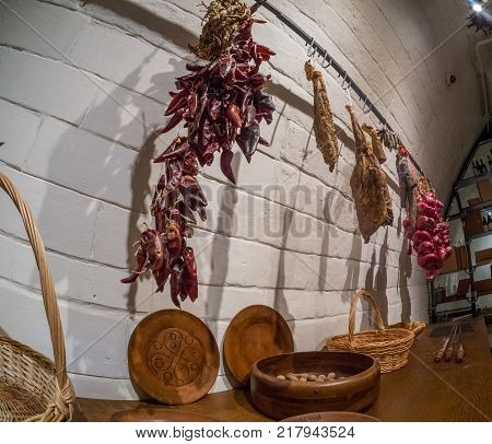 MOSCOW RUSSIA - MAY 31 2017: Capsicum ham and onions hang on hooks at kitchen in restaurant Aragvi in Moscow Russia on May 31 2017. Restaurant was founded by USSR NKVD minister Lavrentiy Beria.