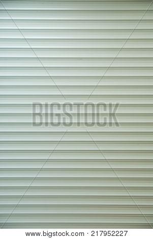 Galvanized Steel Roller Shutter Door, suitable for use as industrial background.