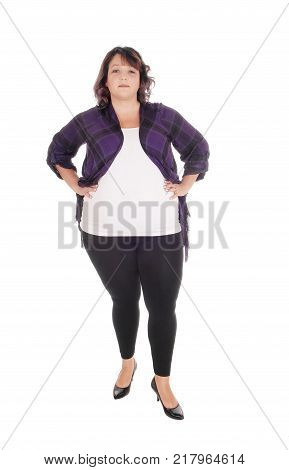 A lovely overweight woman in her forties standing from front in tights isolated for white background