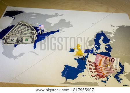 Dollar and euro, american and European flags over EU and US map, symbolizing the Transatlantic Trade and Investment Partnership or TTIP, with the aim of promoting trade and multilateral economic growth