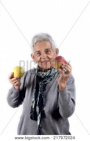 Senior Woman Eating Apple On White