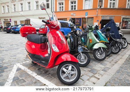 Regensburg Germany - May 5 2017: Colorful Vespa scooters stand in a row on a parking lot in old European town