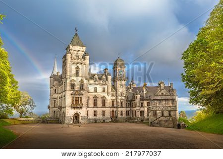 Spectacular rainbow in the dramatic sky at the scenic Dunrobin Castle in Scotland. Northern Highlands in Golspie, the east coast of Scotland, United Kingdom.