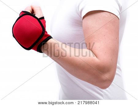 Young woman exercising with one lb weighted glove isolated on white background