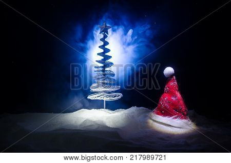 New Years Eve Celebration Background With Pair Of Flutes And Bottle Of Champagne With Christmas Tree