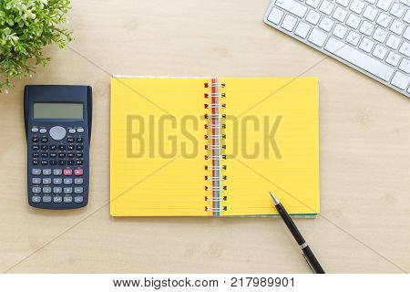 Top View Of Open Book With Yellow Blank Pages Calculator Modern Keyboard Plants And Black Premium Pe