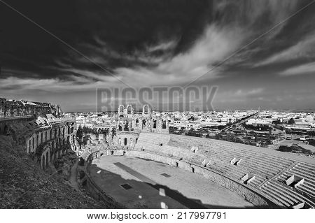 El Djem Amphitheatre in Tunisia. Part with arches of roman biggest amphitheater in africa, monochrome