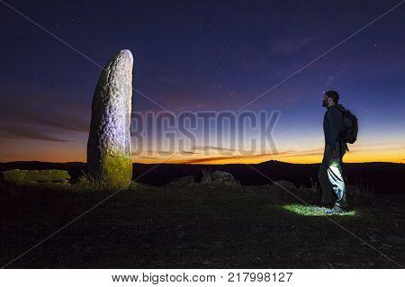 Trekker getting close to Radish Menhir or Menhir del Rabano. Badajoz Spain Valencia del Ventoso