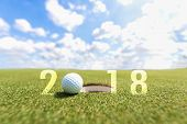 Golf sport conceptual image.Happy new year 2018. Golf ball on the green fairway blue sky background. Holiday and Sport Concept poster