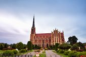 Old ancient castle. Holy Trinity Catholic Church in Gothic Revival style in Gervyaty village Grodno region Belarus. poster