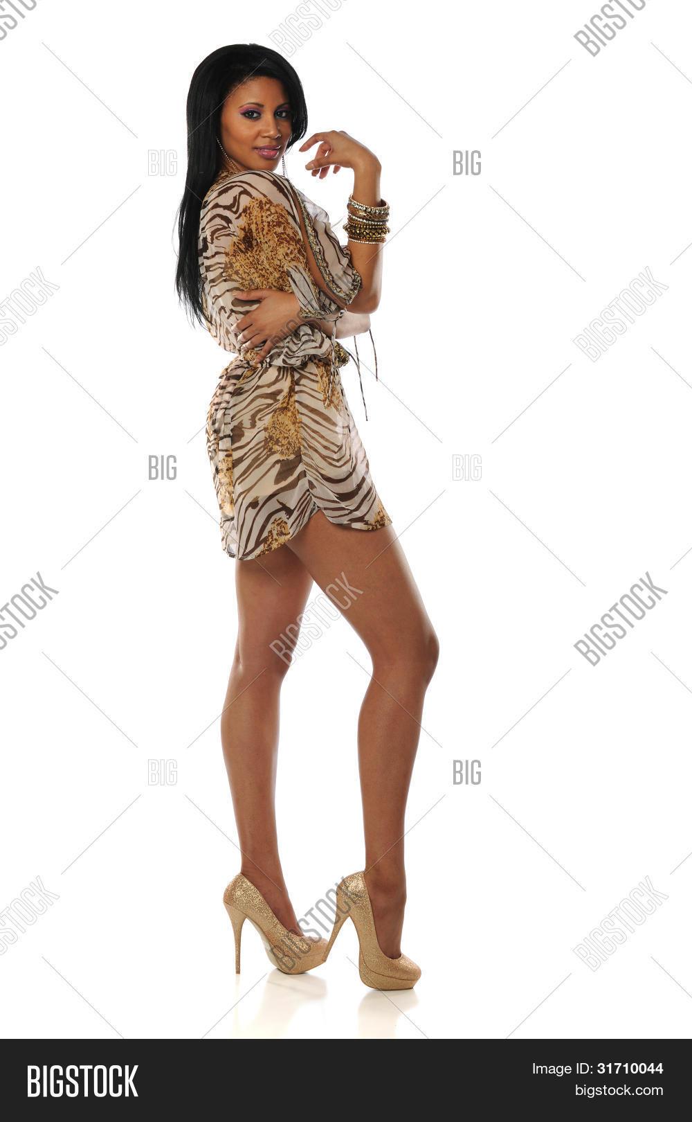 Beautiful African American Woman Wearing A Short Dress And High Heels