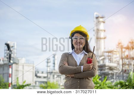 Woman Engineer And Safety Officer Concept.young Woman Engineer Wear Safety Hat (helmet),safety Refle