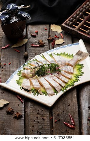Fresh Raw Fish Block In A White Ceramic Dish