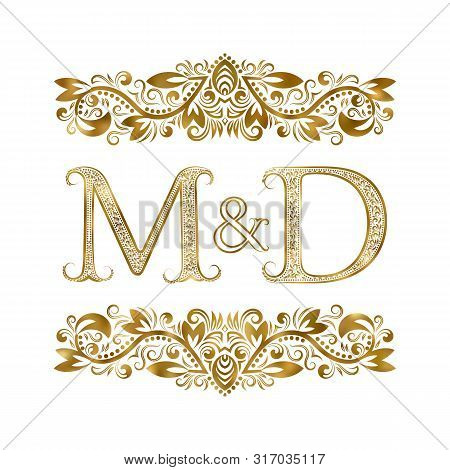 M And D Vintage Initials Logo Symbol. The Letters Are Surrounded By Ornamental Elements. Wedding Or