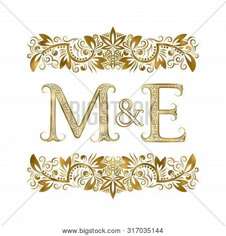 M And E Vintage Initials Logo Symbol. The Letters Are Surrounded By Ornamental Elements. Wedding Or