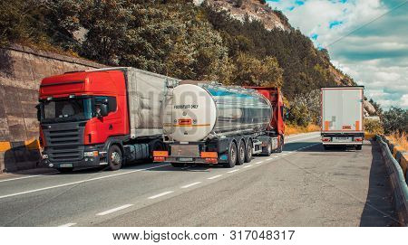 Nebelhorn, Germany. September,15, 2018- Large Trucks Carrying Different Products For Hypermarkets, O