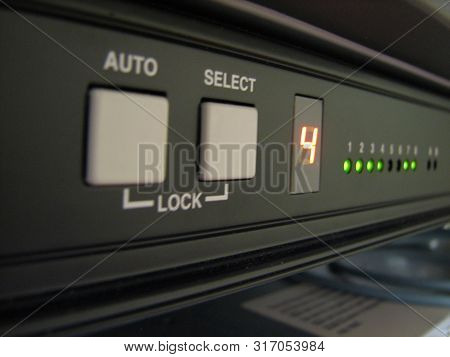 Servers Stack With Disc Drives In A Rack And Glowing Lights