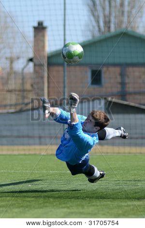 KAPOSVAR, HUNGARY - MARCH 17: Edvard Rusak (goalkeeper) in action at the Hungarian National Championship under 18 game between Kaposvar(white)  and Videoton (blue) March 17, 2012 in Kaposvar, Hungary.