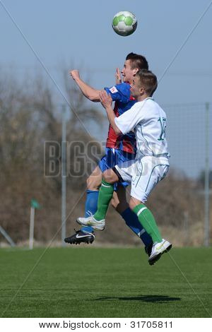 KAPOSVAR, HUNGARY - MARCH 17: Unidentified players in action at the Hungarian National Championship under 18 game between Kaposvar(white)  and Videoton (blue) March 17, 2012 in Kaposvar, Hungary.