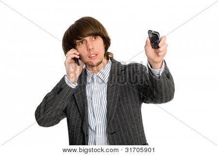 Young stockbroker talking on a mobile arm and points to the side.