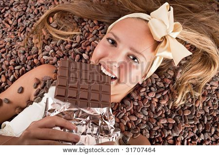Beautiful Girl With Chocolate On Cocoa Beans