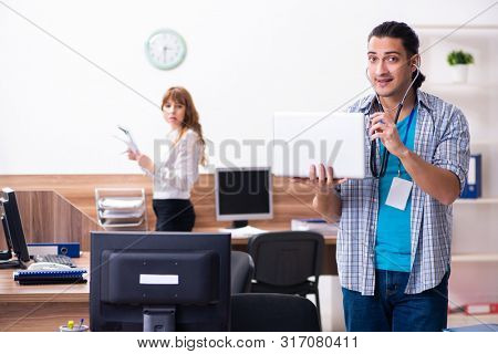 Young male it specialist in the office