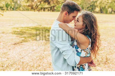 Outdoor Image Of Beautiful Couple In Love Dating Outdoors At The Park On A Sunny Day. Happy Couple I