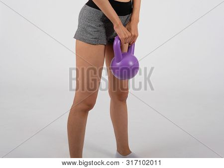 Sporty Woman In Sportswear With Kettlebell Doing Fitness Workout On White Background. Healthy Sport